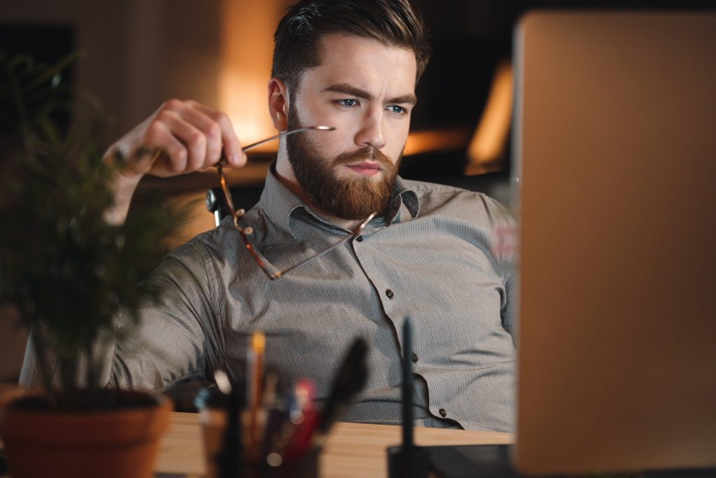 Graphicstock Image Of Tired Web Designer Dressed In Shirt And Wearing Eyeglasses Working Late At Night Hlpuekxu2G